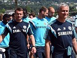 Relaxed: Jose Mourinho leads his Chelsea squad on a walk through the sunny streets of Velden, Austria