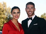 All smiles: Real Madrid defender Sergio Ramos poses at his brother's wedding with his partner Pilar Rubio
