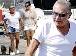 The high life! Roberto Cavalli, 73, sports denim hotpants as he takes his pooches for a stroll with girlfriend Lina Nilson, 26, in Ibiza