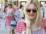 She's a bohemian beauty! Dakota Fanning is eye-catching in billowing patterned dress for solo outing in New York