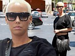 Looking good: Amber Rose flaunted her figure in a crop top with skintight jeans in Studio City, Los Angeles on Thursday