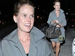 Makeup-free Alice Eve showcases her legs in short trench coat while out to dinner in Beverly Hills