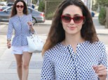 How very Shameless of you! Emmy Rossum struts her long pale limbs in white cut-off shorts while leaving the studio
