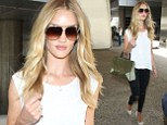 Flying in fine style! Rosie Huntington-Whiteley shows off svelte legs in ripped black skinny jeans as she lands at LAX