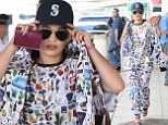 Rita Ora sports an all-over pattern for her arrival in New York City