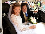 Prince Francois d'Orleans prepares to drive off with his new wife Theresa von Einsiedel after their wedding ceremony today