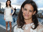Just heavenly! Katie Holmes looks stunning in angelic white lace dress that leaves her long legs on show at rooftop cocktail party