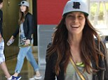Doing the tourist thing! Jessica Biel checks out the sights of Montreal with her family in grey cap, leather jacket and cropped jeans