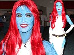 Audrina Patridge, 29, attended the ComicCon convention with her younger sister, Casey Loza, and got into the spirit with a thoroughly executed disguise.  With head-to-toe blue body paint and a long bright red wig, Patridge dressed up as X-Men's and Marvel's bad girl Mystique.