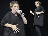 Nothing's going to stop her! Pregnant Sam Bailey strokes baby bump as she performs in all-black outfit at Leicester Music Festival