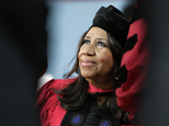FILE - In a Thursday, May 29, 2014 file photo, singer Aretha Franklin looks up while seated on stage during Harvard University commencement ceremonies, in Ca...