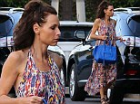 Best unsupported actress! Minnie Driver goes braless as she wears colourful summer dress to party in Los Angeles