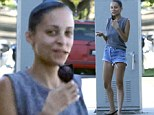 Leggy lady: The 32-year-old TV personality put on a leggy display in tiny denim shorts with a baggy grey tank top, not bothering with make-up