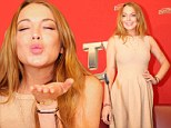 Demure Lindsay Lohan is pretty in peach dress for Austrian festival appearance after enjoying Italian vacation