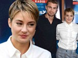 Shailene Woodley goes for an androgynous look in plaid trousers and white shirt as she hits Comic-Con with handsome co-star Theo James