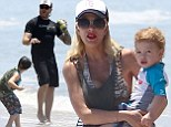 Tori Spelling keeps a close watch while Dean McDermott plays with their youngsters during another family day at the beach