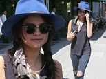 Low-key: The 22-year-old actress and singer went for a grunge look in holey jeans with a tattered shirt