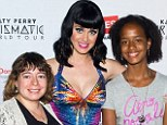 Baby, you're a firework: Katy Perry, 29, showed off her voluptuous curves in a plunging blue bustier, covered in shimmering rhinestones and with a red, orange, yellow and pink starburst design exploding from the center