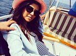 Nothing but smooth sailing! Pregnant Kourtney Kardashian shows off baby bump in clingy dress