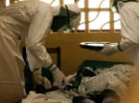Mission: Dr Kent Brantly, pictured tending to an ebola patient in Liberia, is now being treated for the diease