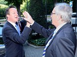 Awkward: David Cameron (left) and European Commission president Jean-Claude Juncker attempt a high-five
