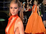 Bright and beautiful! Nicola Peltz reveals side-boob in daringly low-cut orange dress at Tokyo premiere for Transformers: Age of Extinction