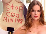 Naked truth: Full-figured model Robyn Lawley uses red lipstick to scrawl political slogan on bare stomach as she says, 'I want people to read this - one way or another'