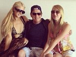 Peas in a pod: Paris Hilton posted a picture of herself partying with Charlie Sheen and his fiancee Scottine on Sunday