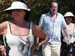 Joan Collins shows off her trim figure in floral print swimsuit as she enjoys lavish St Tropez break with husband Percy Gibson