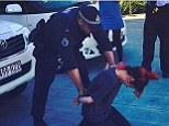 Lily Allen and Australian Federal Police staged a fake arrest at Gold Coast Airport on Sunday