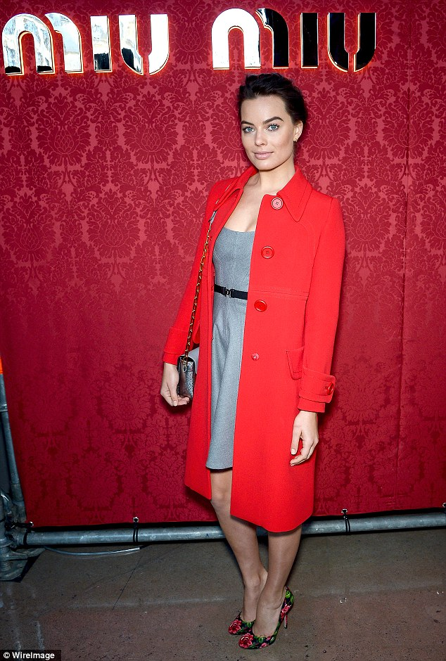 Lady in red: Margot was stylish in a red coat worn over a demure grey dress and teamed with some floral heels