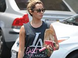 But she's rich and lives in a mansion! Ashley Tisdale tries to look gangster in tank top that highlights one of LA's roughest neighborhoods