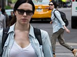 On the run! Orange Is The New Black star Laura Prepon energetically stretches her legs in New York