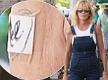 She really IS a working girl! Melanie Griffith wears overalls while showing off 'Mel' bandage covering her 'Antonio' tattoo