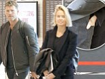 She can't keep her hands off him! Loved-up Lara Bingle tucks her hand into Sam Worthington's back pocket as the pair land in Sydney