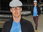 Rock 'n' roller: Benedict Cumberbatch touches down in London wearing Pink Floyd t-shirt after whirlwind trip to California