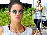 A bare-faced Alessandra Ambrosio wears a tank top and two-toned yoga pants while grabbing an iced drink and filling up her car with gas