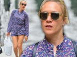 Prints charming! Chloe Sevigny shows off her long legs in purple playsuit and heeled trainers while shopping for artwork