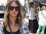 Jessica Alba dresses down in a black maxi-dress to grab lunch at a trendy LA food truck