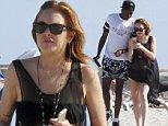 Lindsay Lohan continues enjoying her holidays at the spanish island of Ibiza\n\nPictured: Lindsay Lohan\nRef: SPL810696  290714  \nPicture by: Splash News\n\nSplash News and Pictures\nLos Angeles: 310-821-2666\nNew York: 212-619-2666\nLondon: 870-934-2666\nphotodesk@splashnews.com\n