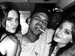 Who knew they were friends? Kendall and Kylie Jenner were seen partying with Chris Brown on Saturday night, also pictured rapper Trey Songz (left)