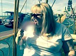 'This doesn't suck!': says Rebel Wilson as she raises eyebrows by licking a pink adult toy while taking a tour around English city in a horse-drawn golden carriage