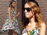 Marilyn moment! Alexa Chung flashes some leg when gust of wind blows her floral dress up during a smoke break