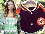 Preparing for baby: Stacy Keibler dusts off her old baseball jacket and places in daughter's closet... just one month before her arrival