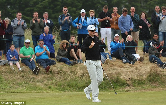 On top: Justin Rose celebrates his birdie on the 16th hole during the third round on Saturday