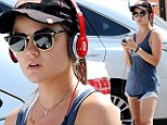 She's working on it! Lucy Hale shows off lean pins in running shorts as she dons athletic gear for fitness regimen