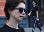 Barefaced Anne Hathaway showcases her flawless complexion as she sports wet hair for early morning workout
