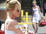 The big cover-up: Melanie Griffith steps out in stunning white sleeveless dress... as she continues to conceal 'Antonio' tattoo