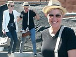 Hollywood wives: Ellen DeGeneres and Portia de Rossi are all smiles - and hugs - as they step out for a spot of high-end shopping