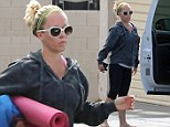 Focusing on herself: Kendra Wilkinson cuts a gloomy figure as she heads to yoga amid marriage strife
